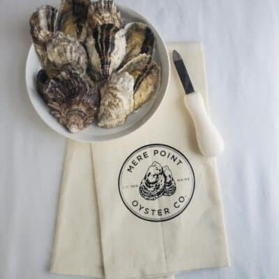 oysters with knife and kitchen towel